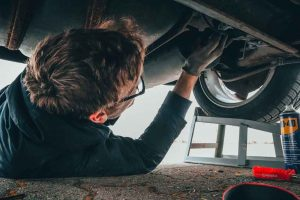 picture of a mechanic servicing a car